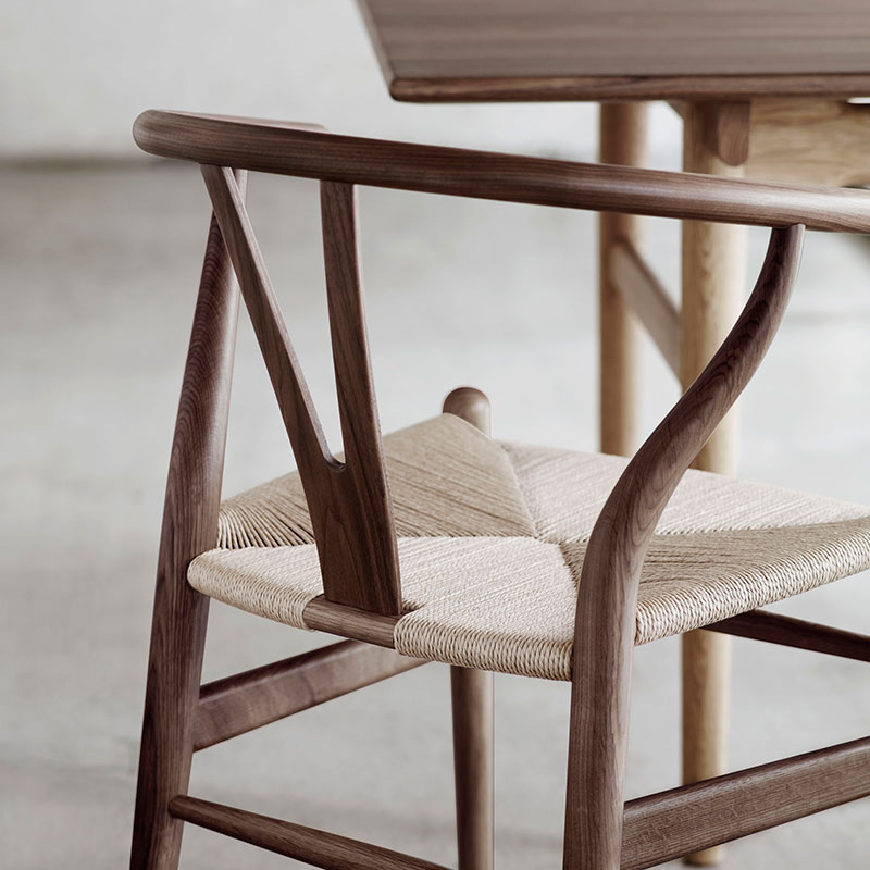 Carl Hansen CH24 Wishbone Chair by Hans Wegner life 2 Olson and Baker - Designer & Contemporary Sofas, Furniture - Olson and Baker showcases original designs from authentic, designer brands. Buy contemporary furniture, lighting, storage, sofas & chairs at Olson + Baker.