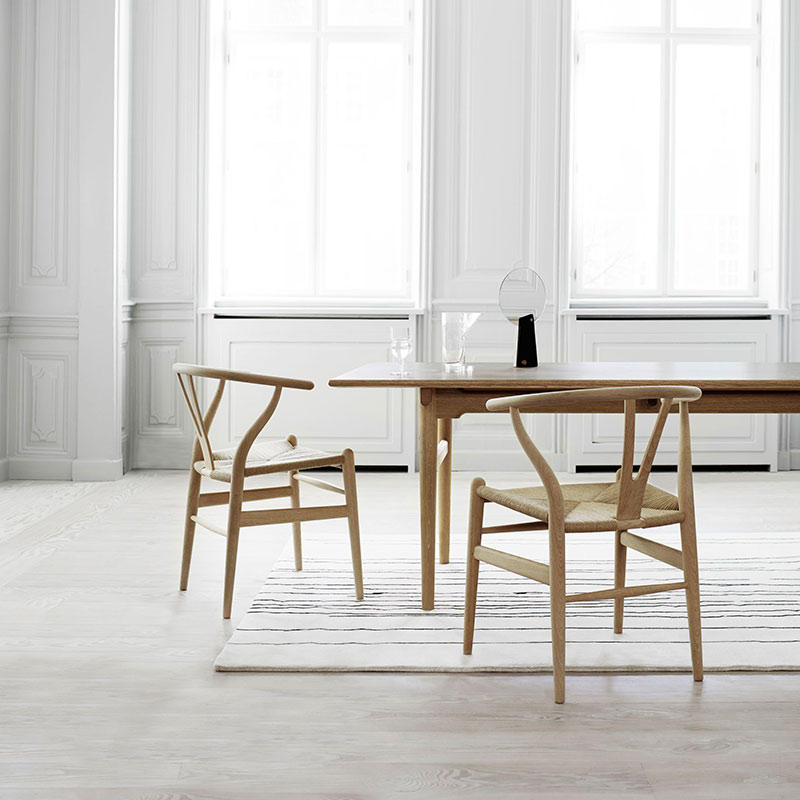 Carl Hansen CH24 Wishbone Chair by Hans Wegner life 3 Olson and Baker - Designer & Contemporary Sofas, Furniture - Olson and Baker showcases original designs from authentic, designer brands. Buy contemporary furniture, lighting, storage, sofas & chairs at Olson + Baker.