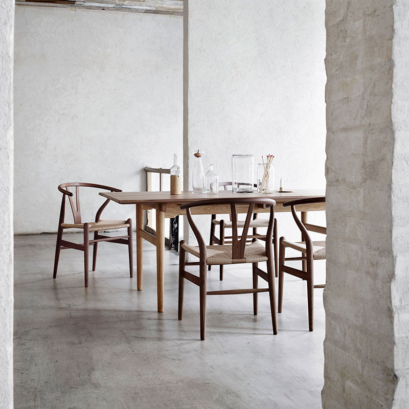 Carl Hansen CH24 Wishbone Chair by Hans Wegner life 4 Olson and Baker - Designer & Contemporary Sofas, Furniture - Olson and Baker showcases original designs from authentic, designer brands. Buy contemporary furniture, lighting, storage, sofas & chairs at Olson + Baker.