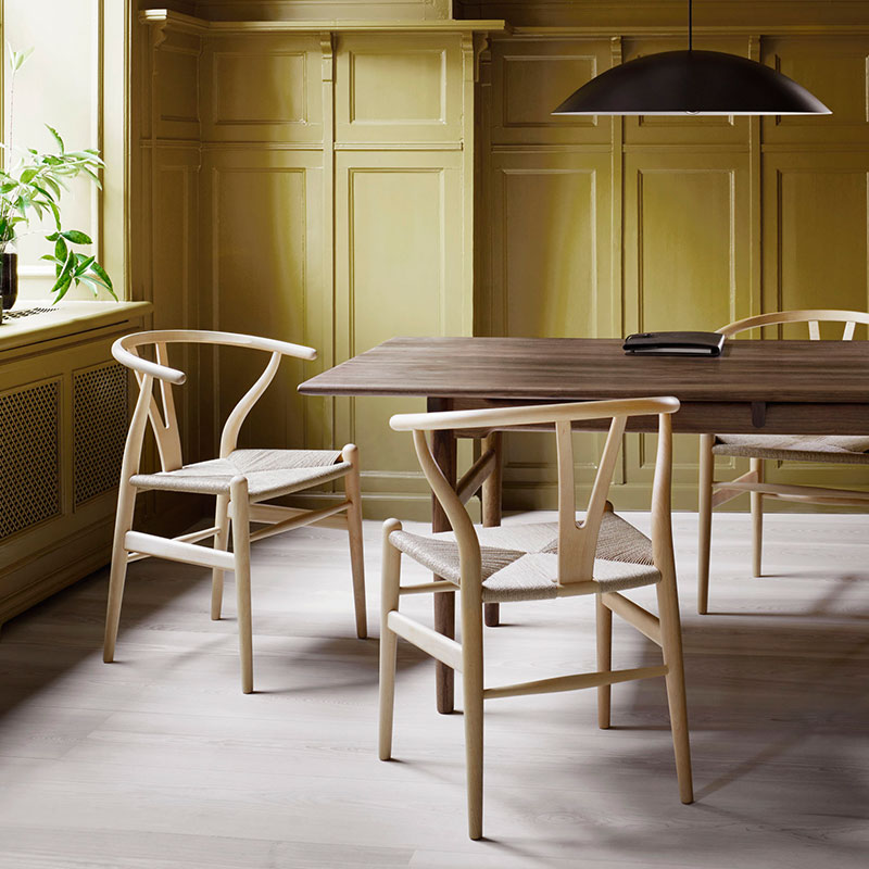 Carl Hansen CH24 Wishbone Chair by Hans Wegner life 6 Olson and Baker - Designer & Contemporary Sofas, Furniture - Olson and Baker showcases original designs from authentic, designer brands. Buy contemporary furniture, lighting, storage, sofas & chairs at Olson + Baker.