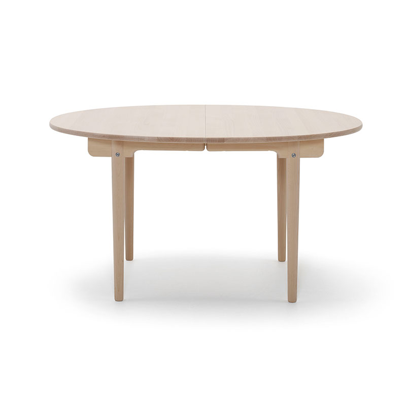 Carl Hansen CH337 Round 140-280x115cm Extendable Dining Table by Hans Wegner Olson and Baker - Designer & Contemporary Sofas, Furniture - Olson and Baker showcases original designs from authentic, designer brands. Buy contemporary furniture, lighting, storage, sofas & chairs at Olson + Baker.