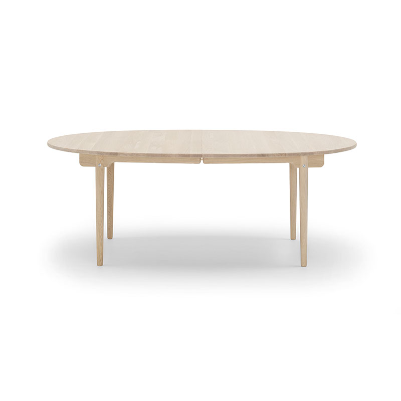 Carl Hansen CH338 Oval 200-440x115cm Extendable Dining Table by Hans Wegner Olson and Baker - Designer & Contemporary Sofas, Furniture - Olson and Baker showcases original designs from authentic, designer brands. Buy contemporary furniture, lighting, storage, sofas & chairs at Olson + Baker.