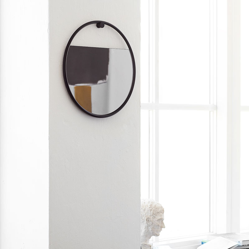 Northern_Peek_Circular_Wall_Mirror_Large_by_Elina Ulvio_Lifeshot_02 Olson and Baker - Designer & Contemporary Sofas, Furniture - Olson and Baker showcases original designs from authentic, designer brands. Buy contemporary furniture, lighting, storage, sofas & chairs at Olson + Baker.