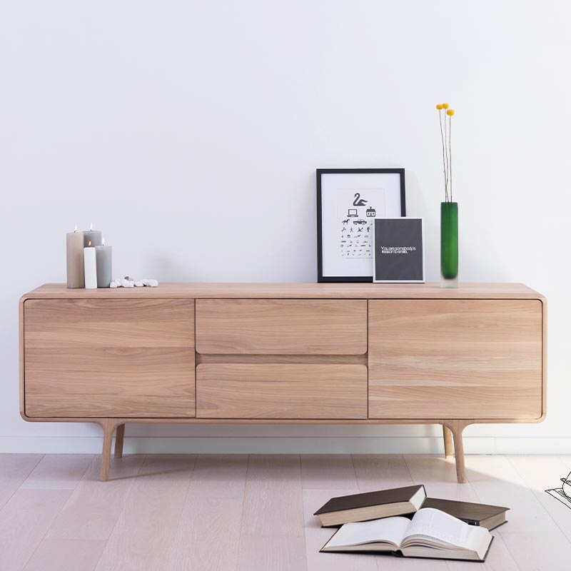 Gazzda_Fawn_Sideboard_in_Solid_Oak_by_Salih_Teskeredzic_Lifeshot_01 Olson and Baker - Designer & Contemporary Sofas, Furniture - Olson and Baker showcases original designs from authentic, designer brands. Buy contemporary furniture, lighting, storage, sofas & chairs at Olson + Baker.