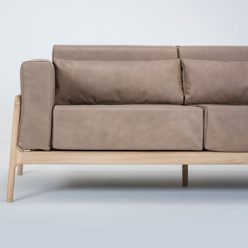 Gazzda_Fawn_Sofa_Two_Seater_by_Salih_Teskeredzic_Gazzda_-_1015_White_Solid_Oak_Oiled_with_1436_Stone_Dakar_Leather_Upholstery_02 Olson and Baker - Designer & Contemporary Sofas, Furniture - Olson and Baker showcases original designs from authentic, designer brands. Buy contemporary furniture, lighting, storage, sofas & chairs at Olson + Baker.