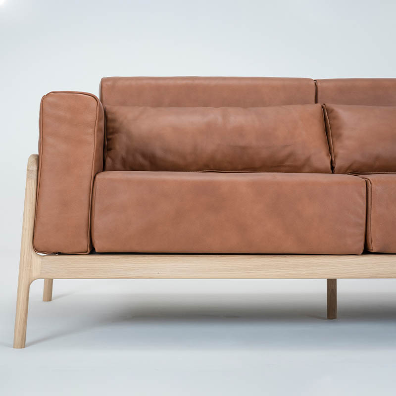 Gazzda_Fawn_Sofa_Two_Seater_by_Salih_Teskeredzic_Gazzda_-_1015_White_Solid_Oak_Oiled_with_2732_Whiskey_Dakar_Leather_Upholstery_03 Olson and Baker - Designer & Contemporary Sofas, Furniture - Olson and Baker showcases original designs from authentic, designer brands. Buy contemporary furniture, lighting, storage, sofas & chairs at Olson + Baker.